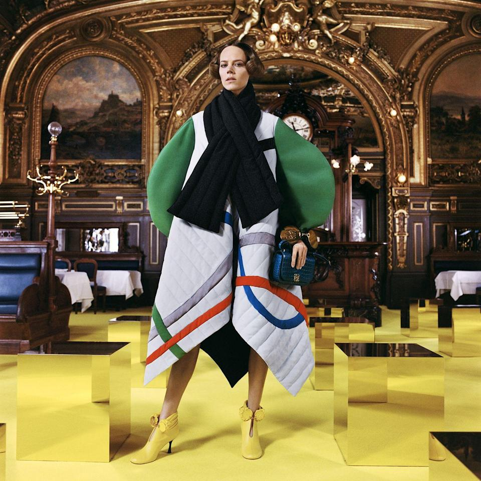 "<p>Jonathan Anderson was all about ""electricity"" for Loewe's autumn/winter 2021 collection, embracing statement shapes and colour, everything was ""pumped up to the max"".</p><p>""An exploded palette of bright, acrylic hues is juxtaposed in graphic compositions then mapped onto abstract silhouettes that swing around the body, drape all over it and sprout out of it,"" the show notes read. ""The sheer joy of fashion-making is harnessed to convey an idea of dressing up as an audacious act, marking a point of departure towards new grounds. Hedonism is switched on.""<br></p>"