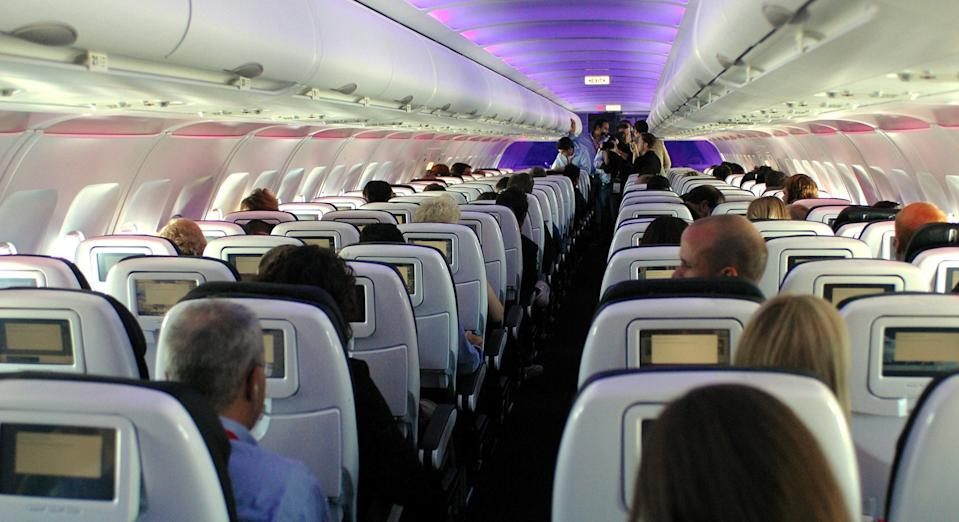 An ex-air hostess has revealed the dirty habits of passengers on flights {Image: Getty]