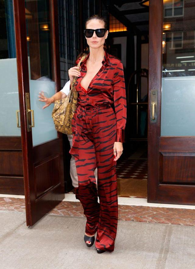 Heidi Klum recently stepped out in a zebra-print jumpsuit in New York City. (Photo: Getty Images)