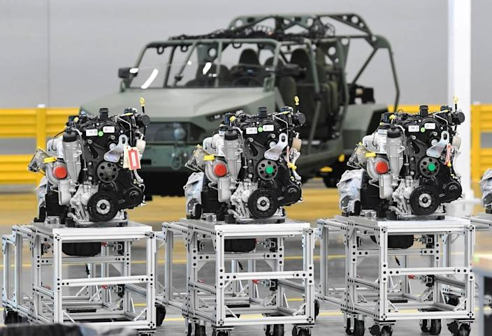 Engines are placed along the assembly line of the new Infantry Squad Vehicle.