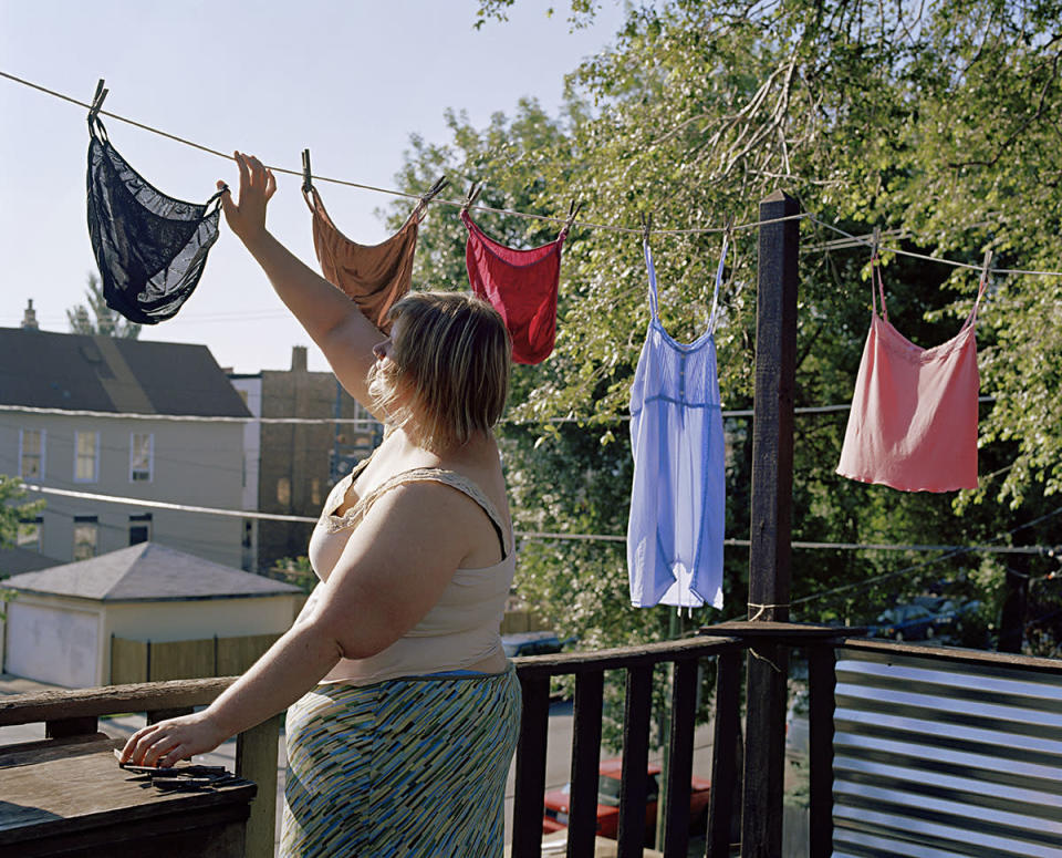 "<div class=""caption-credit""> Photo by: Jen Davis Photo</div>Untitled: ""I'm doing something totally mundane here, laundry, but I'm actually exposing myself because I'm hanging my underwear, such an intimate item of clothing,"" says <a href=""http://jendavisphoto.com/"" rel=""nofollow noopener"" target=""_blank"" data-ylk=""slk:Davis"" class=""link rapid-noclick-resp"">Davis</a>. ""It forces people to look at the large size, which contrasts with the pretty color and silk material."""