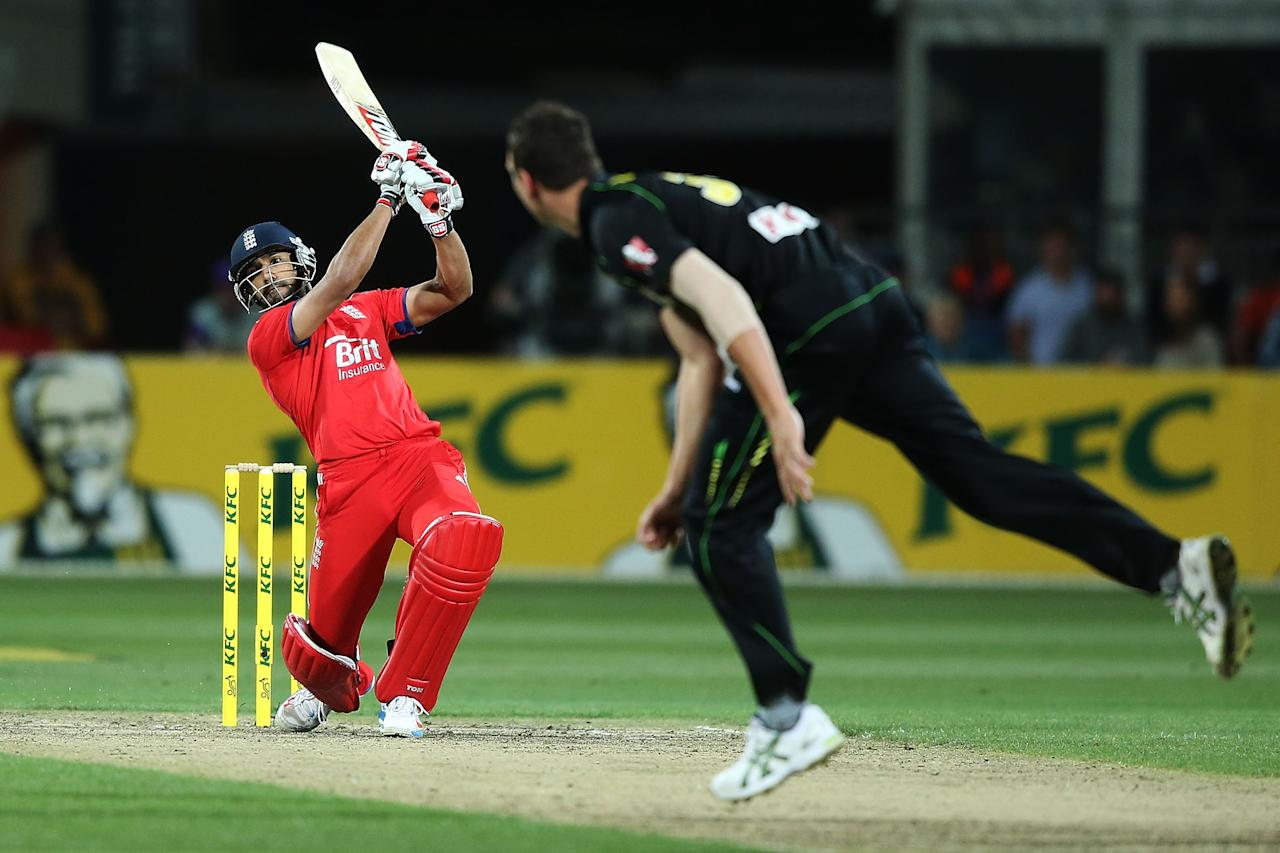 HOBART, AUSTRALIA - JANUARY 29:  Ravi Bopara of England hits a boundary against Josh Hazelwood of Australia during game one of the International Twenty20 series between Australia and England at Blundstone Arena on January 29, 2014 in Hobart, Australia.  (Photo by Michael Dodge/Getty Images)