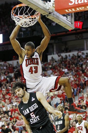 UNLV's Mike Moser dunks over San Diego State's Garrett Green during the second half of an NCAA college basketball game on Saturday, Feb. 11, 2012, in Las Vegas. UNLV won 65-63. (AP Photo/Isaac Brekken)