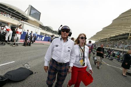 Former Formula One champion Sir Jackie Stewart walks in the grid with his wife Helen before the Bahrain F1 Grand Prix at the Sakhir circuit in Manama