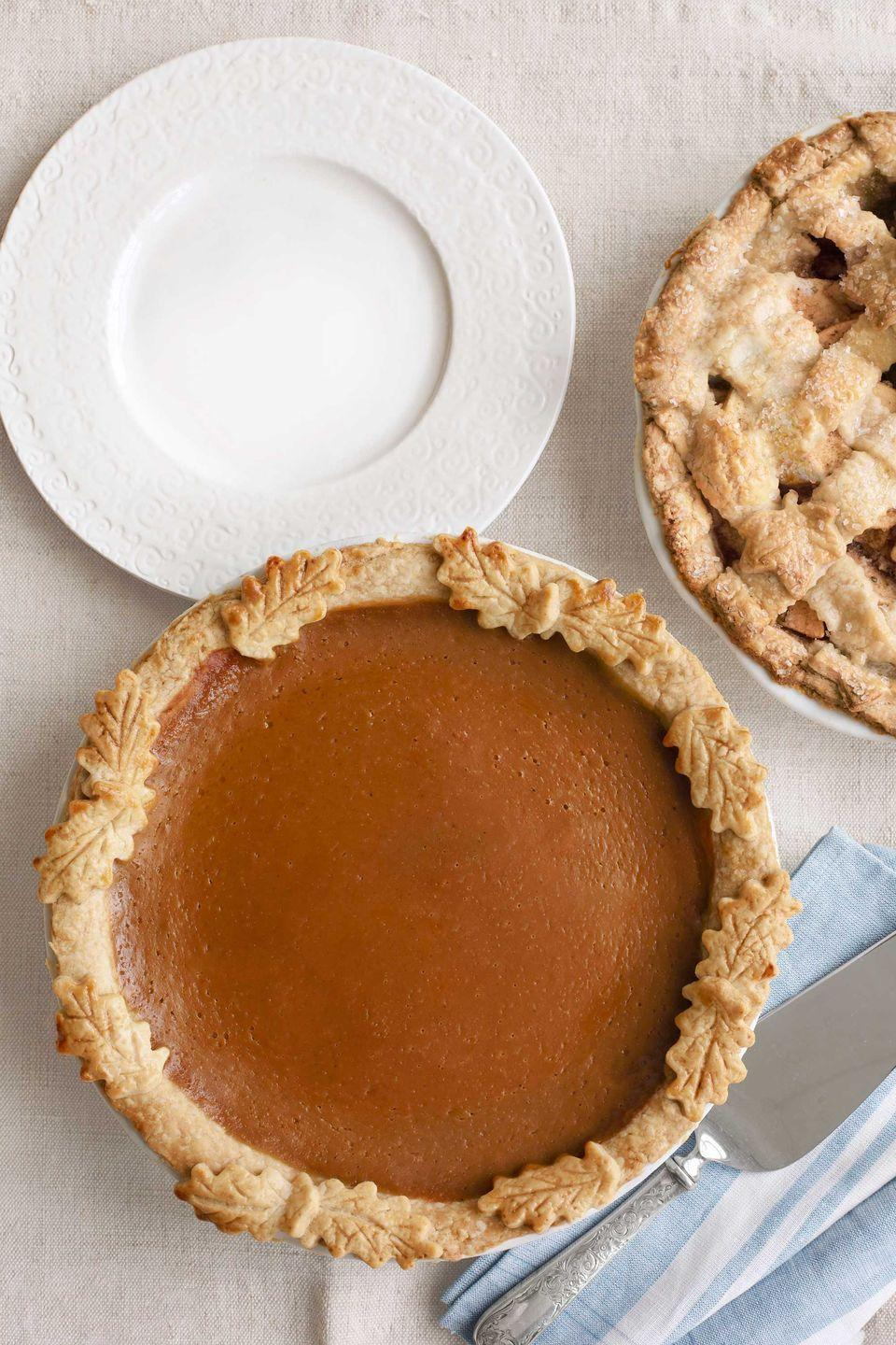 """<p>A traditional Southern dessert, this rich sweet potato pie turns fall produce into a spectacular holiday treat.<br></p><p><strong><a href=""""https://www.countryliving.com/food-drinks/recipes/a3900/sour-cream-sweet-potato-pie-recipe-clx1111/"""" rel=""""nofollow noopener"""" target=""""_blank"""" data-ylk=""""slk:Get the recipe"""" class=""""link rapid-noclick-resp"""">Get the recipe</a>.</strong></p><p><a class=""""link rapid-noclick-resp"""" href=""""https://www.lodgecastiron.com/product/seasoned-cast-iron-pie-pan?sku=BW9PIE"""" rel=""""nofollow noopener"""" target=""""_blank"""" data-ylk=""""slk:SHOP CAST IRON PIE PANS"""">SHOP CAST IRON PIE PANS</a></p>"""