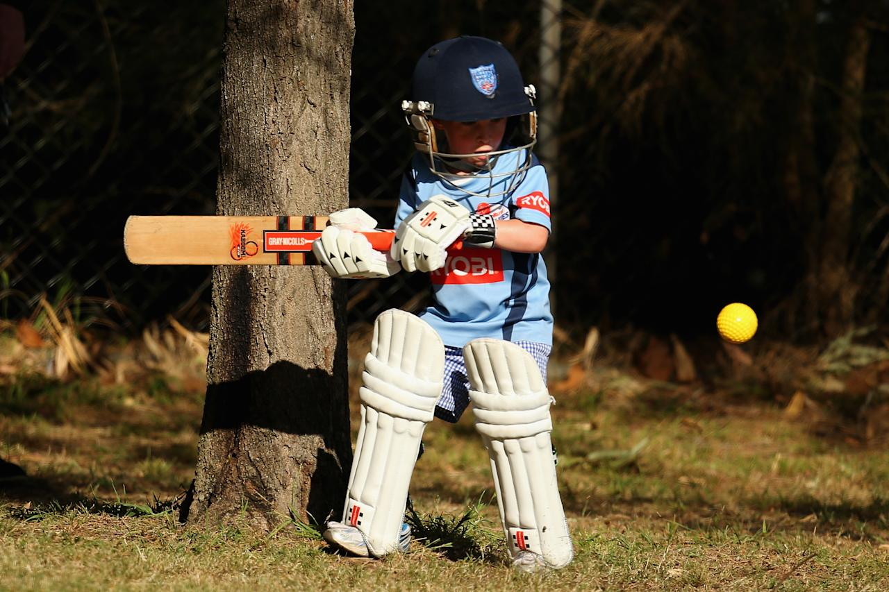 SYDNEY, AUSTRALIA - SEPTEMBER 29:  A small boy plays cricket during the Ryobi Cup match between the New South Wales Blues and the Tasmania Tigers at Bankstown Oval on September 29, 2013 in Sydney, Australia.  (Photo by Mark Kolbe/Getty Images)