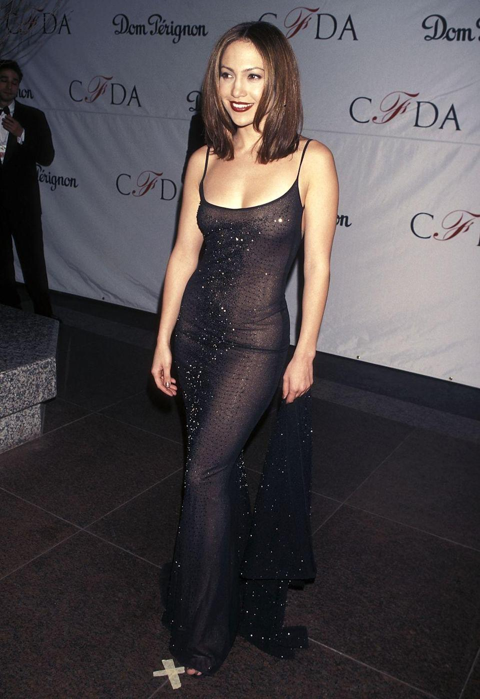"<p>J.Lo sported this ""barely there"" black spaghetti-strap number at the 17th annual CFDA Awards. Honey, it fits like a glove.</p>"