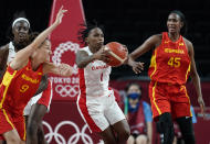 Canada's Shaina Pellington (1) grabs a rebound in front of Spain's Laia Palau (9) and Astou Ndour (45) during women's basketball preliminary round game at the 2020 Summer Olympics, Sunday, Aug. 1, 2021, in Saitama, Japan. (AP Photo/Charlie Neibergall)