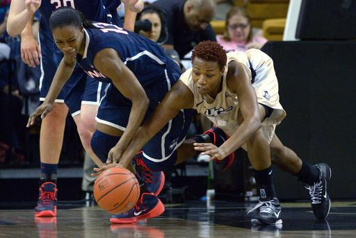 Connecticut guard Brianna Banks (13) and Central Florida's Erika Jones, right, battle for a loose ball during the first half of an NCAA college basketball game in Orlando, Fla., Wednesday, Jan. 1, 2014.(AP Photo/Phelan M. Ebenhack)