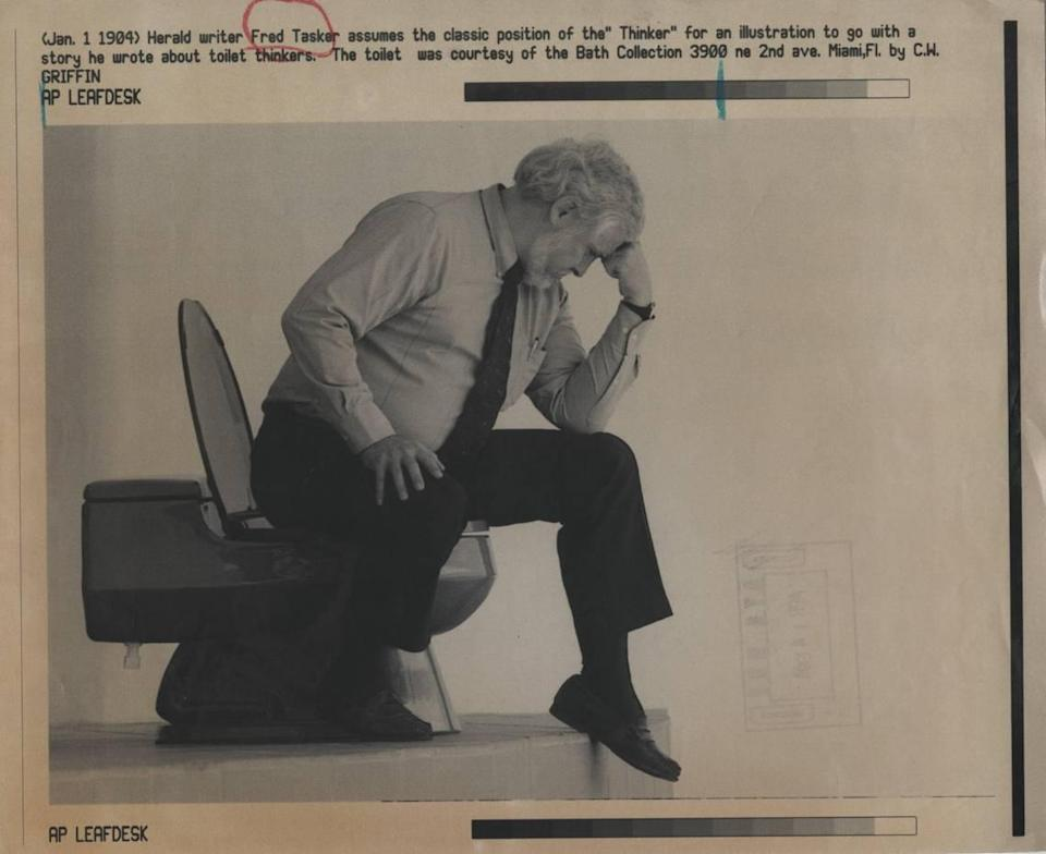 """Fred Tasker assumes the classic position of the """"Thinker"""" for an illustration to go with a Jan. 1, 1994, story he wrote for the Miami Herald about toilet thinkers. The toilet was courtesy of the Bath Collection in Miami."""