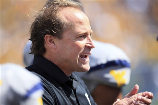 West Virginia coach Dana Holgorsen encourages his side during their NCAA college football game against Maryland in Morgantown, W.Va., Saturday, Sept. 22, 2012. WVU won 31-21 (AP Photo/Christopher Jackson)