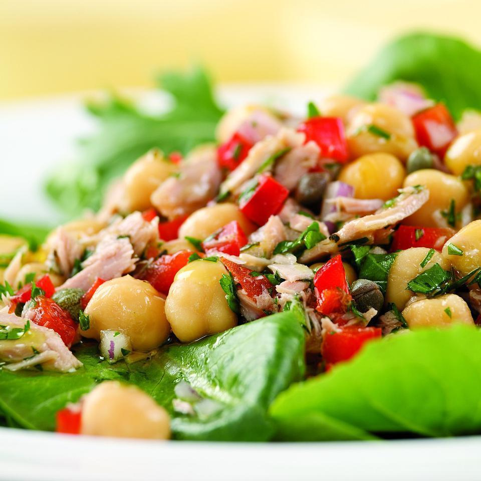 <p>Capers, red onion and fresh herbs give canned tuna and beans a light, fresh taste. Here we serve the tuna salad on a bed of greens. It also works well stuffed into a pita for a sandwich. Give it some extra kick with a pinch of crushed red pepper or cayenne. Serve with olive bread.</p>