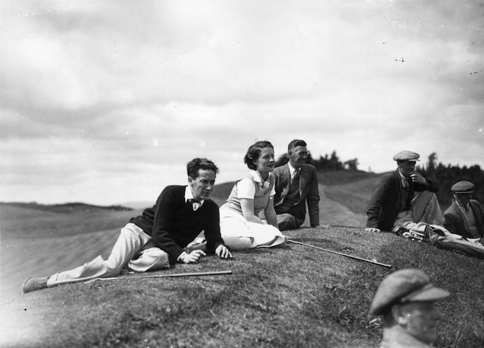 <p>Actress Norma Shearer and husband, Irving Thalberg, relax at Gleneagles Hotel, Perthshire, Scotland.</p><p>Other celebrity visitors this year: Katherine Hepburn.<br></p>