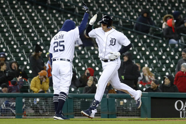 Detroit Tigers' Grayson Greiner celebrates his solo home run with third base coach Dave Clark (25) during the eighth inning of the team's baseball game against the Chicago White Sox in Detroit, Friday, April 19, 2019. (AP Photo/Paul Sancya)