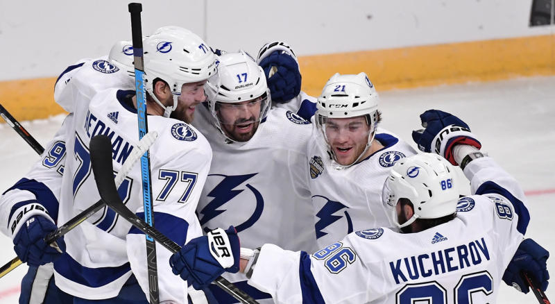 Tampa Bay Lightning's Victor Hedman (77). Alex Killorn (17) and Nikita Kucherov (86) celebrate after an NHL hockey game against the Buffalo Sabres in Globen Arena, Stockholm Sweden. Friday. Nov. 8, 2019. (Anders Wiklund/TT via AP)