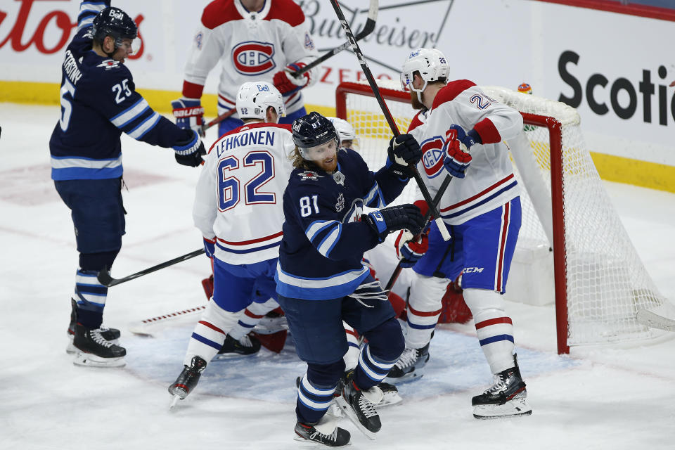 Winnipeg Jets' Kyle Connor (81) celebrates after scoring against Montreal Canadiens goaltender Carey Price (31) during second-period NHL hockey game action in Winnipeg, Manitoba, Thursday, Feb. 25, 2021. (John Woods/The Canadian Press via AP)