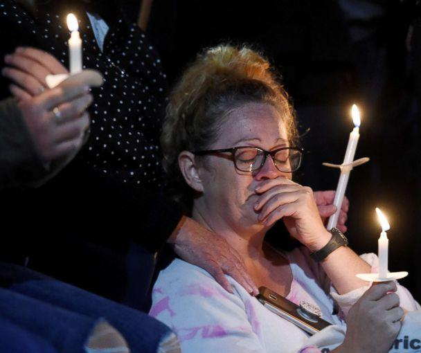 PHOTO: A family member, who asked not to be identified, mourns during a candlelight vigil for the victims of a limousine accident in upstate New York, in Amsterdam, N.Y., Oct. 8, 2018. (Cindy Schultz/Reuters)