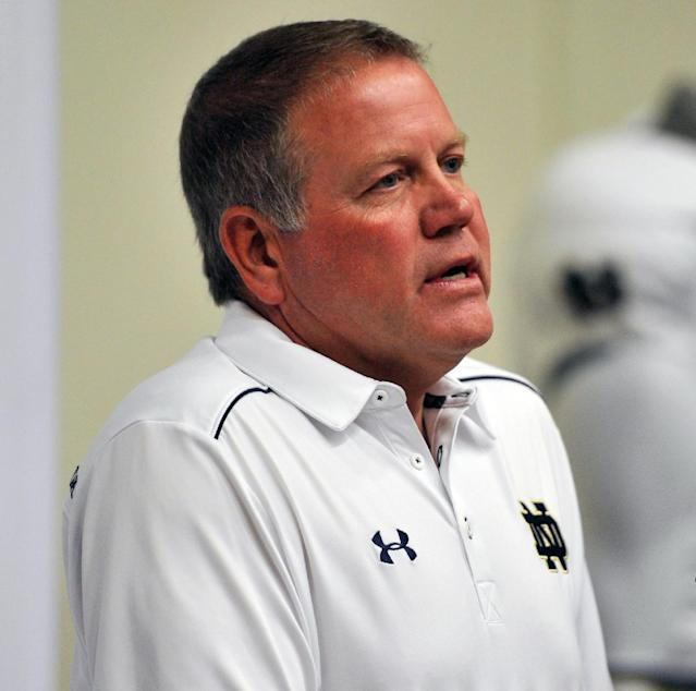 Notre Dame coach Brian Kelly talks to the media during media day for the NCAA college football team Tuesday Aug. 19, 2014, in South Bend, Ind. (AP Photo/Joe Raymond)