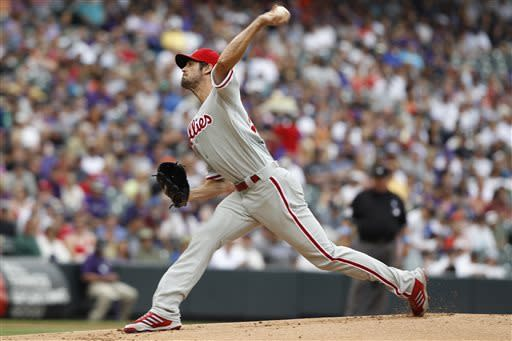 Philadelphia Phillies starting pitcher Cole Hamels works against the Colorado Rockies in the first inning of a baseball game in Denver on Sunday, June 16, 2013. (AP Photo/David Zalubowski)