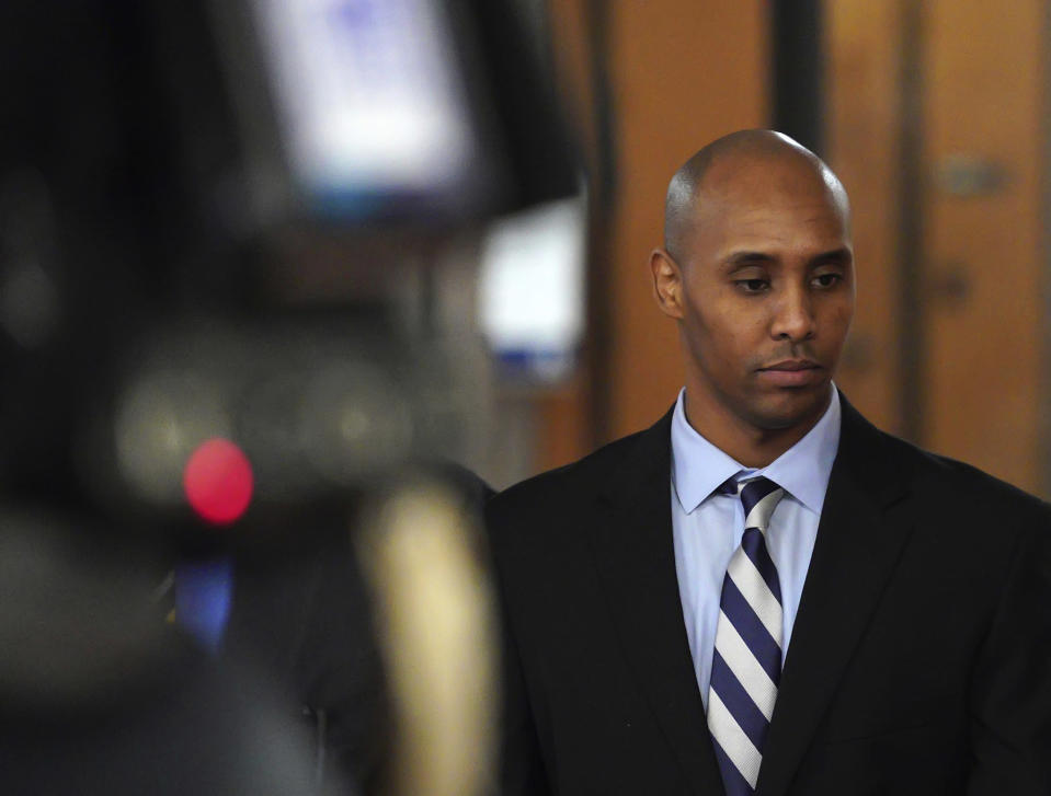 FILE - In this April 25, 2019, file photo, former Minneapolis police Officer Mohamed Noor walks out of the Hennepin County courthouse in Minneapolis. Prosecutors fought hard to add a third-degree murder charge against former Officer Derek Chauvin in the death of George Floyd, but a conviction on that charge alone could set up a problematic scenario for them. The interpretation of Minnesota's third-degree murder statute is being challenged by Noor, who was found guilty in a deadly 2017 shooting. If Noor's conviction is thrown out, a Chauvin conviction could collapse, too. (Brian Peterson/Star Tribune via AP, File)