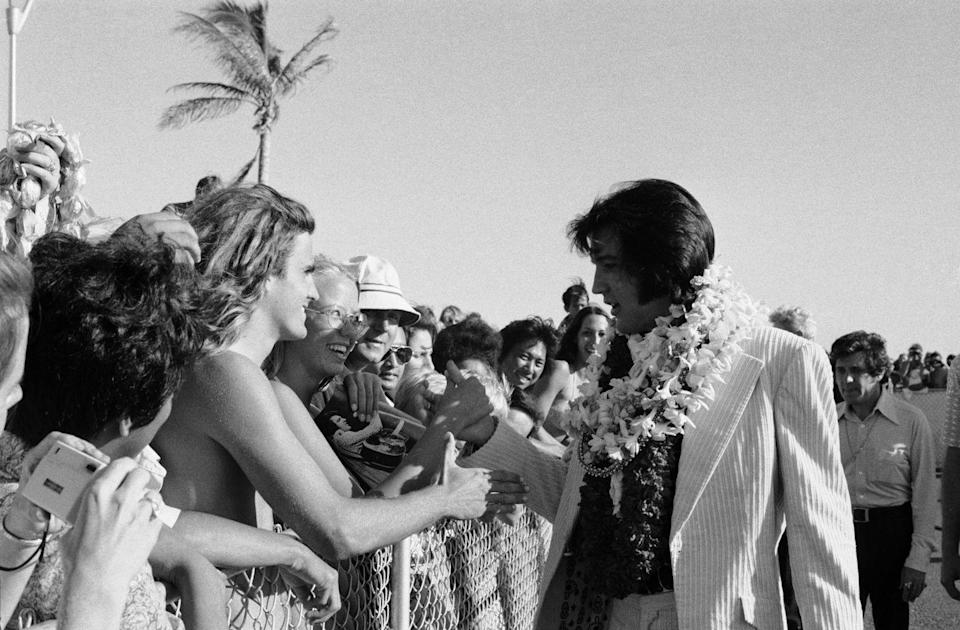 <p>Elvis Presley in Hawaii. </p><p>Other celebrity visitors this year: Mick Jagger, Vice President Gerald Ford.</p>
