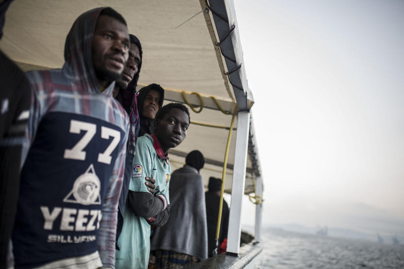 Migrants look out from the deck of the Spanish NGO Proactiva Open Arms rescue vessel, after being rescued Dec. 21, in the Central Mediterranean Sea, before disembarking in the port of Crinavis in Algeciras, Spain, Friday, Dec. 28, 2018. To reach Crinavis they have sailed for 6 days with more than 300 migrants on board because other European countries closed their ports to the ship.(AP Photo/Olmo Calvo)