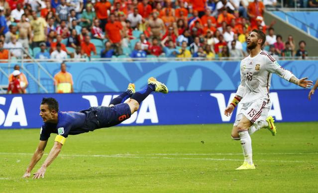 Spain's Ramos reacts as van Persie of the Netherlands scores during their 2014 World Cup Group B soccer match at the Fonte Nova arena in Salvador
