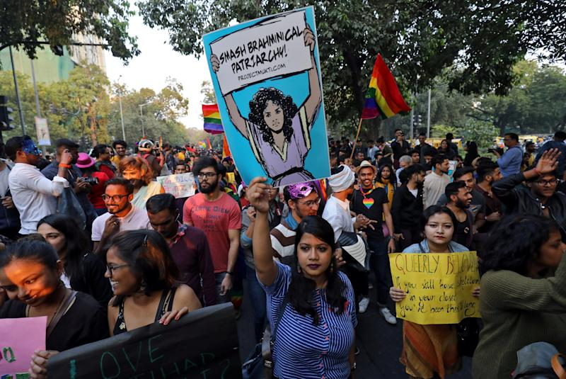 People carry placards as they attend Queer Pride March, an event promoting gay, lesbian, bisexual and transgender rights, in New Delhi