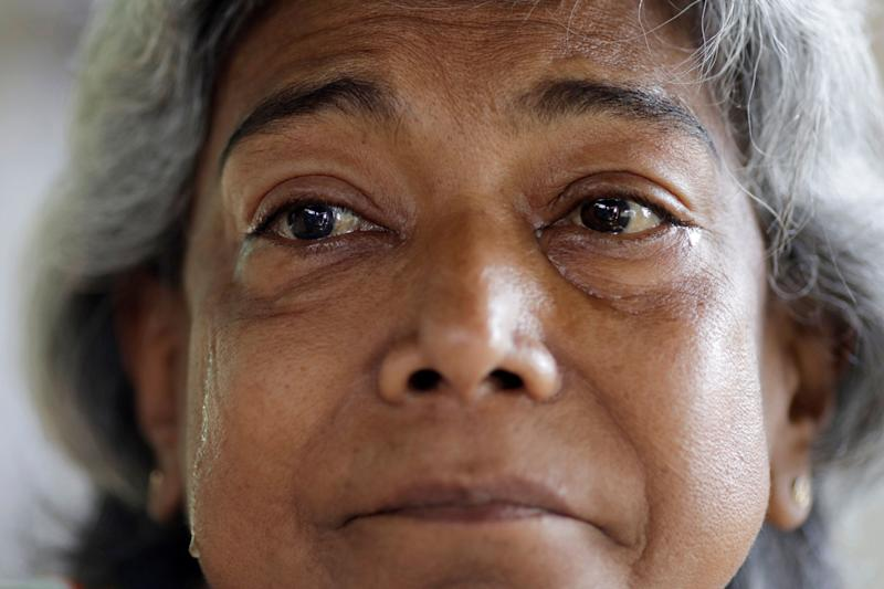 "Lesbia Avila de Molina, 53, a kidney disease patient, cries due to pain when she is in her house during a blackout in Maracaibo, Venezuela. Avila said she woke up feeling ill one recent morning after receiving just one hour and 40 minutes of treatment the prior day due to the lack of power and equipment shortages at her Maracaibo, Venezuela, clinic. She said she feels like she is choking when she does not receive full treatment. ""I just ask God that if I die, it will not be of choking,"" said Avila. (Photo: Ueslei Marcelino/Reuters)"