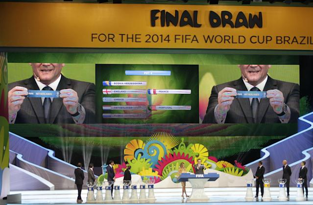 FIFA Secretary General Jerome Valcke holds the ticket of the Netherlands during the draw ceremony for the 2014 soccer World Cup in Costa do Sauipe near Salvador, Brazil, Friday, Dec. 6, 2013. (AP Photo/Silvia Izquierdo)