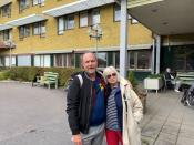 Ingrid Bolander, on her way to visit husband admitted to the care facility, poses with her son Pelle Bolander, in Gothenburg
