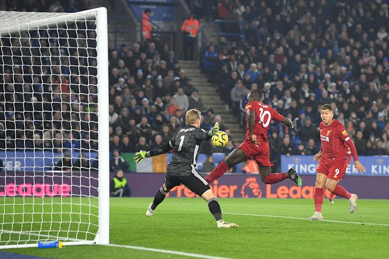 LEICESTER, ENGLAND - DECEMBER 26: Sadio Mane of Liverpool misses a chance under pressure from Kasper Schmeichel of Leicester City during the Premier League match between Leicester City and Liverpool FC at The King Power Stadium on December 26, 2019 in Leicester, United Kingdom. (Photo by Michael Regan/Getty Images)