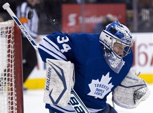 Toronto Maple Leafs goaltender James Reimer makes a save against the Ottawa Senators during first-period NHL hockey game action in Toronto, Wednesday, March 6, 2013. (AP Photo/The Canadian Press, Frank Gunn)