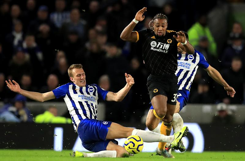 Brighton and Hove Albion's Dan Burn challenges Wolverhampton Wanderers' Adama Traore Brighton and Hove Albion v Wolverhampton Wanderers - Premier League - Amex Stadium 08-12-2019 . (Photo by Adam Davy/EMPICS/PA Images via Getty Images)