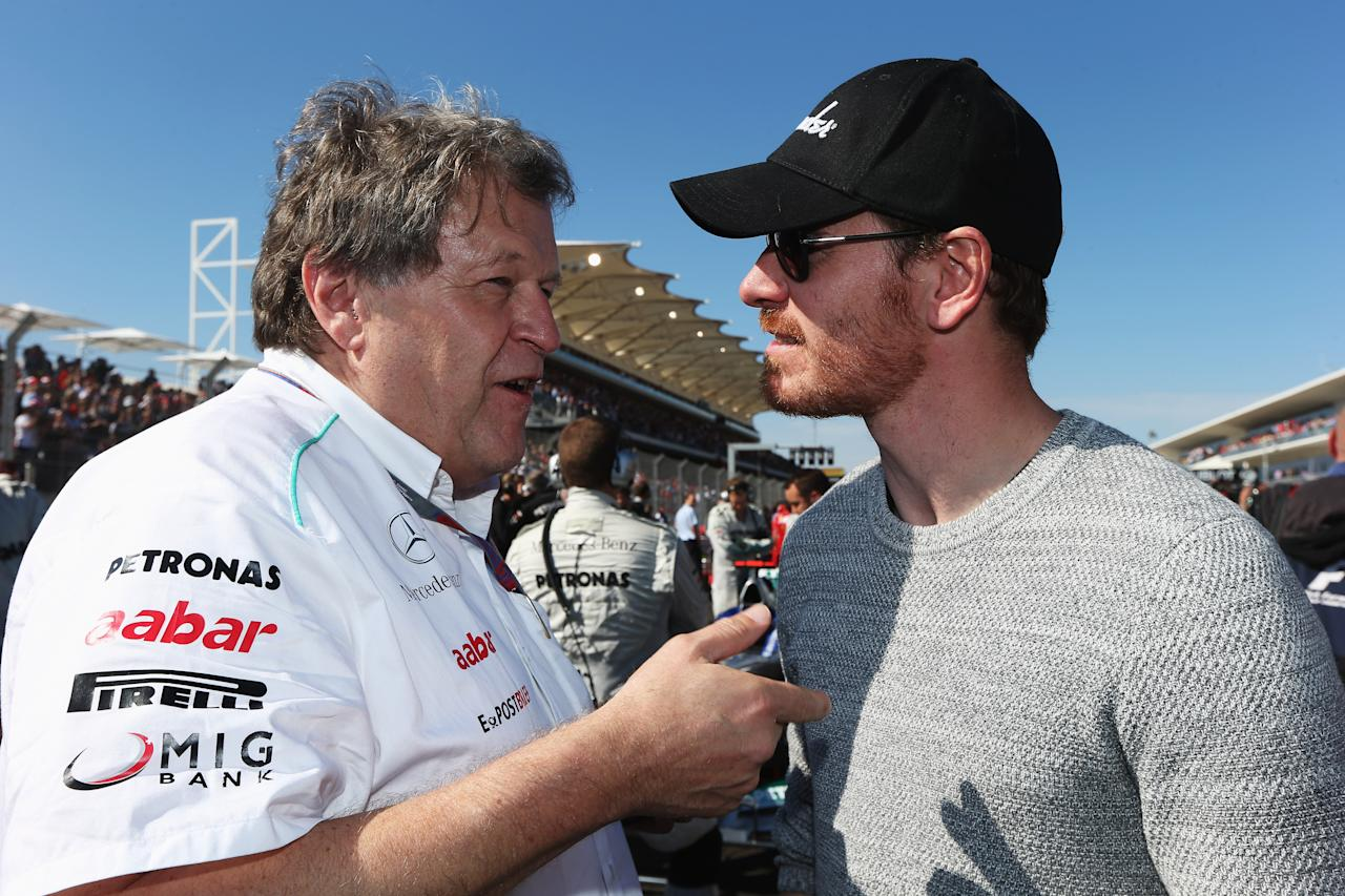 AUSTIN, TX - NOVEMBER 18:  Actor Michael Fassbender talks with Norbert Haug of Mercedes on the grid before the United States Formula One Grand Prix at the Circuit of the Americas on November 18, 2012 in Austin, Texas.  (Photo by Mark Thompson/Getty Images)