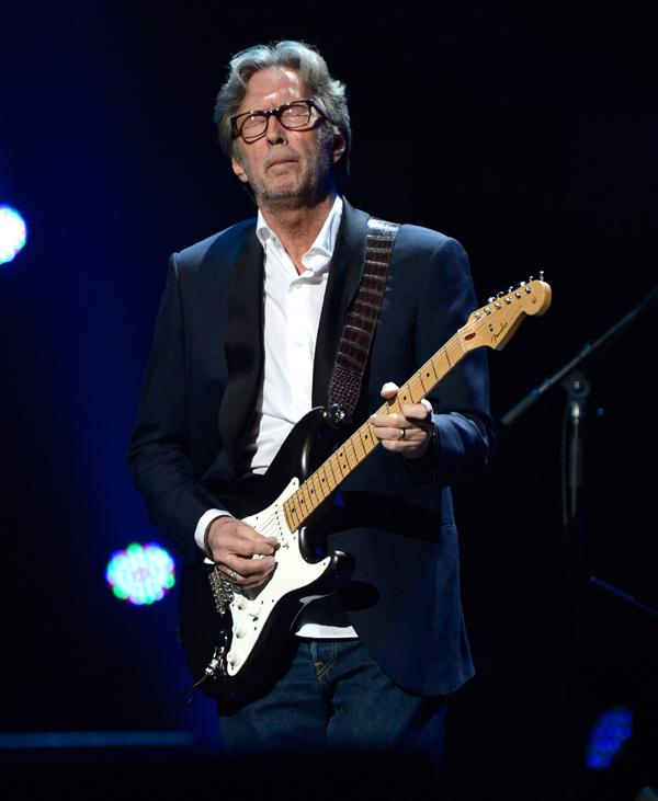 """Eric Clapton performs at """"12-12-12"""", a concert benefiting The Robin Hood Relief Fund to aid the victims of Hurricane Sandy."""
