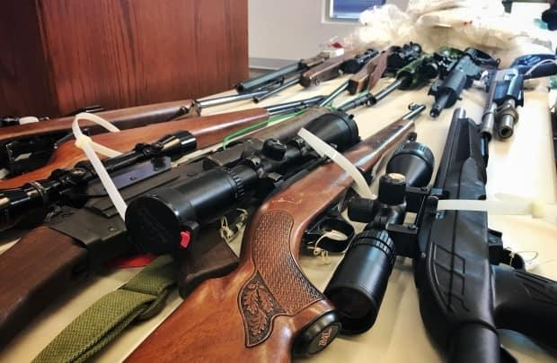 Guns are shown in this file photo from a weapons seizure in 2018. Police say a large number of illegal weapons on B.C. streets are purchased within Canada.