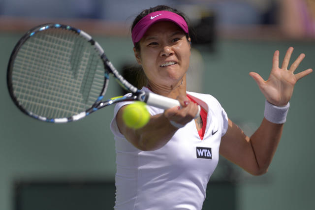 Li Na, of China, hits a return to Dominika Cibulkova, of Slovakia, during a quarterfinal match at the BNP Paribas Open tennis tournament, Thursday, March 13, 2014 in Indian Wells, Calif. (AP Photo/Mark J. Terrill)