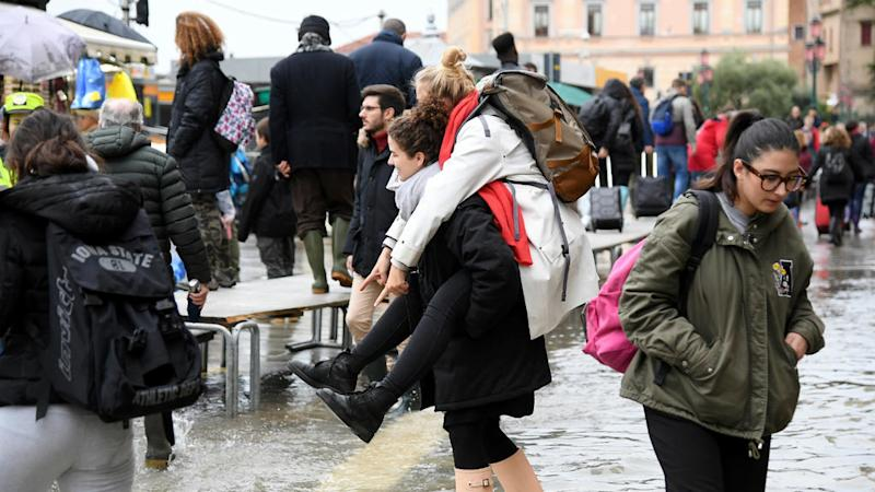 Venice hit by third exceptional tide in a week as rain lashes Italy