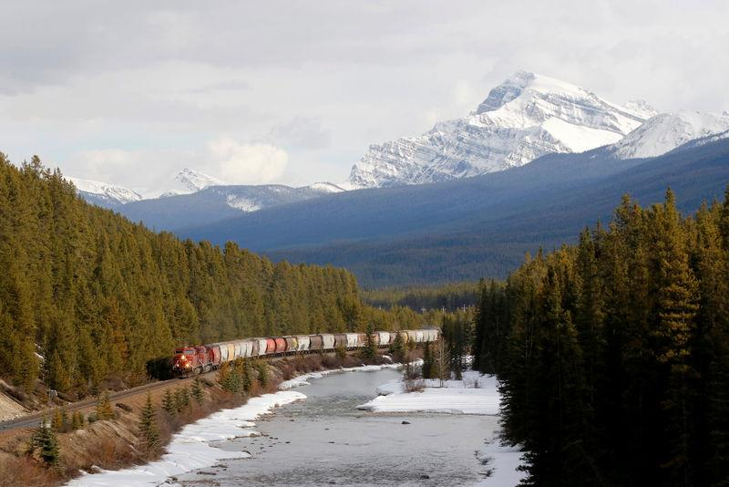 FILE PHOTO: A CP Rail train rolls across the prairies into the rocky mountains of near Canmore.