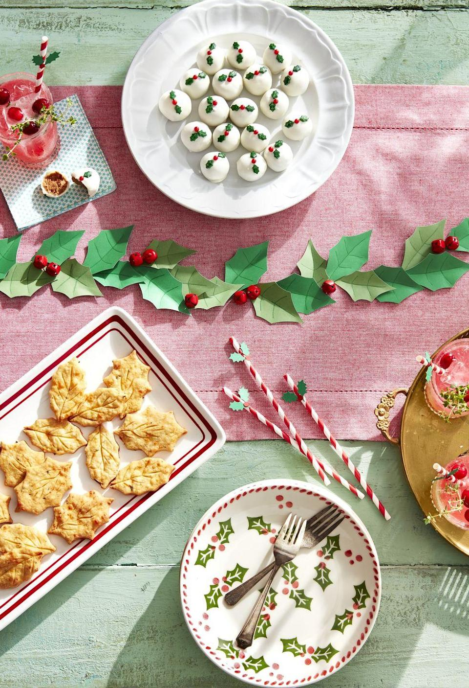 """<p>The classic holly berry just might be one of the most recognizable signs of the season. In this party idea, it's highlighted in nearly every part of the table, from the straws to the vintage plates and even the <a href=""""https://www.countryliving.com/food-drinks/a29640166/white-chocolate-truffles-recipe/"""" rel=""""nofollow noopener"""" target=""""_blank"""" data-ylk=""""slk:white chocolate truffles"""" class=""""link rapid-noclick-resp"""">white chocolate truffles</a>.</p><p><a class=""""link rapid-noclick-resp"""" href=""""https://www.amazon.com/Wilton-W5085-Sprinkles-3oz-Holly/dp/B0761XS1V7?tag=syn-yahoo-20&ascsubtag=%5Bartid%7C10050.g.2218%5Bsrc%7Cyahoo-us"""" rel=""""nofollow noopener"""" target=""""_blank"""" data-ylk=""""slk:SHOP HOLLY BERRY SPRINKLES"""">SHOP HOLLY BERRY SPRINKLES</a></p>"""