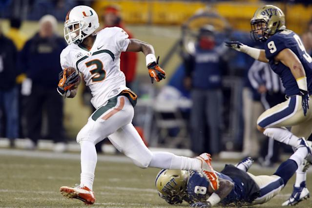 Miami wide receiver Stacy Coley (3) runs away from Pittsburgh linebacker Todd Thomas (8) and defensive back Ray Vinopal (9) on his way to score a touchdown on an end around in the second quarter of an NCAA college football game in Pittsburgh on Friday, Nov. 29, 2013. (AP Photo/Keith Srakocic)