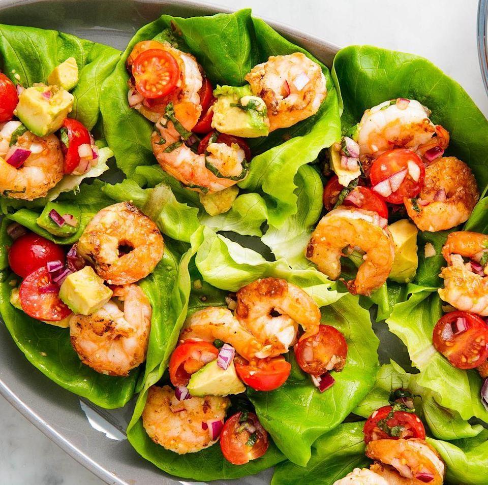 """<p>Lettuce wraps are the one of the best ways to eat healthy (and low carb). These wraps are stuffed with our new favourite twist on prawn salad: basil avocado.</p><p>Get the <a href=""""https://www.delish.com/uk/cooking/recipes/a34959586/avocado-shrimp-salad-lettuce-wraps-recipe/"""" rel=""""nofollow noopener"""" target=""""_blank"""" data-ylk=""""slk:Basil Avocado Prawn Salad Wraps"""" class=""""link rapid-noclick-resp"""">Basil Avocado Prawn Salad Wraps</a> recipe.</p>"""