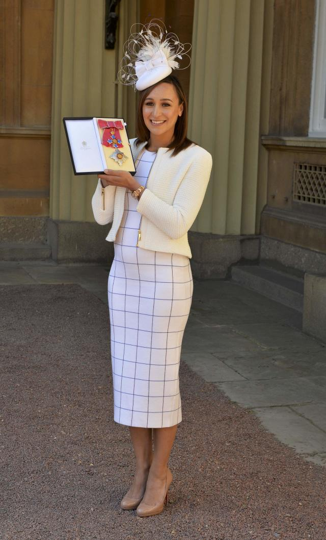 Athlete Jessica Ennis-Hill holds her award after she was made a Dame CBE by the Duke of Cambridge during an investiture ceremony at Buckingham Palace in London, Britain April 19, 2017. REUTERS/John Stillwell/Pool