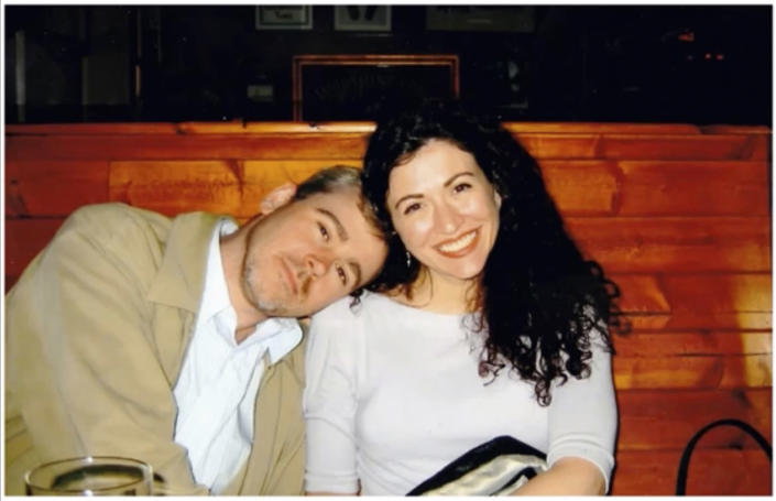 In this 2004 photo provided by Julia Silverman, Associated Press reporter Steven DuBois, left, poses for a photo with his longtime friend Laura Tempesta in Portland, Ore. DuBois, a two-decade veteran of the wire service known for his skillful storytelling and attention to detail, died Tuesday, Oct. 12, 2021, after a three-year battle with cancer. He was 53. (Julia Silverman via AP)