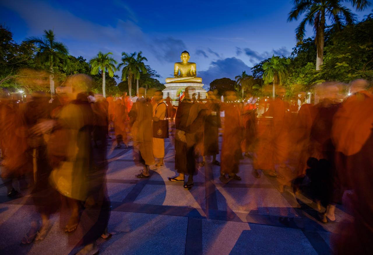 <p>In this long exposure photograph, Monks from Myanmar residing in Sri Lanka engage in a peaceful demonstration to show solidarity with Buddhist community in Myanmar at Colombo, Sri Lanka, Sept. 19, 2017. (Photo: Tharaka Basnayaka/NurPhoto via Getty Images) </p>