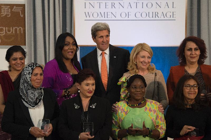 US Secretary of State John Kerry poses with recipients of the 2016 International Women of Courage Award at the State Department in Washington, DC, March 29, 2016