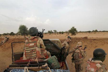 Niger soldiers guard with their weapons pointed towards the border with neighbouring Nigeria, near the town of Diffa