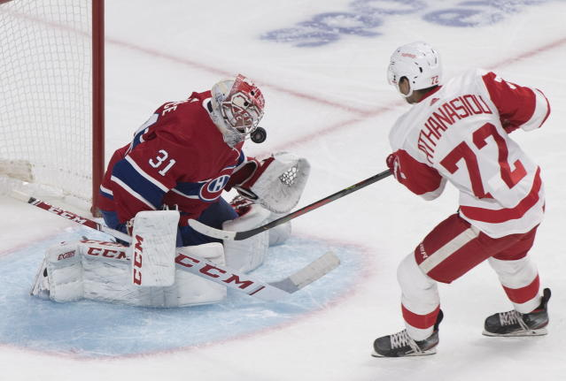 Detroit Red Wings' Andreas Athanasiou, right, shoots against Montreal Canadiens goaltender Carey Price during second-period NHL hockey game action in Montreal, Thursday, Oct. 10, 2019. (Graham Hughes/The Canadian Press via AP)