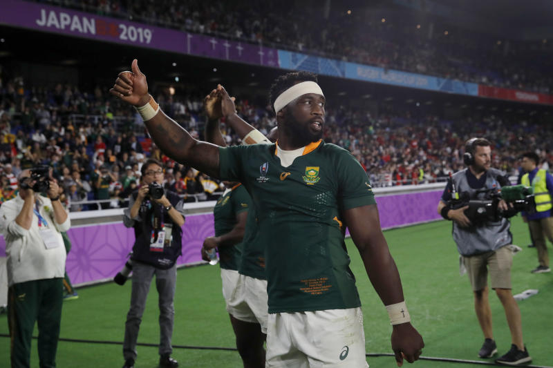 South Africa's Siya Kolisi celebrates after the Rugby World Cup semifinal at International Yokohama Stadium between Wales and South Africa in Yokohama, Japan, Sunday, Oct. 27, 2019. South Africa won 19-16. (AP Photo/Christophe Ena)